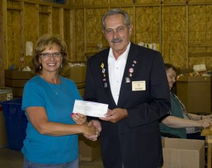 Pictured with Executive Director, Lucinda Schaefer, is Macon Elks Lodge #999 Exalted Ruler, Cecil Arnett, making a donation from the Elks Lodge.